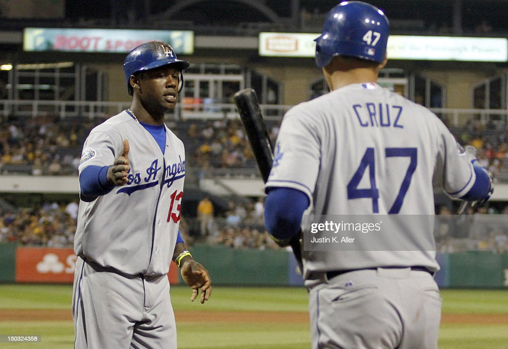<a gi-track='captionPersonalityLinkClicked' href=/galleries/search?phrase=Hanley+Ramirez&family=editorial&specificpeople=538406 ng-click='$event.stopPropagation()'>Hanley Ramirez</a> #13 of the Los Angeles Dodgers scores on a RBI single in the seventh inning against the Pittsburgh Pirates during the game on August 15, 2012 at PNC Park in Pittsburgh, Pennsylvania.