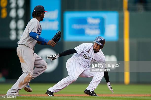 Hanley Ramirez of the Los Angeles Dodgers sets to tag out Jair Jurrjens of the Colorado Rockies after Jurrjens was picked off and caught stealing...