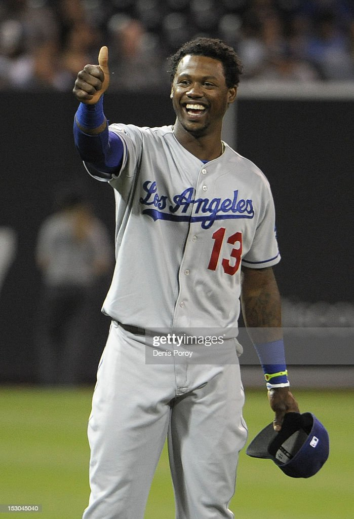 Hanley Ramirez #13 of the Los Angeles Dodgers signals to fans before a baseball game against the San Diego Padres at Petco Park on September 27, 2012 in San Diego, California.