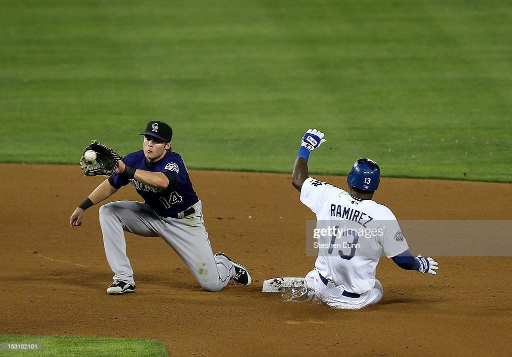 Hanley Ramirez #13 of the Los Angeles Dodgers slides into second with a stolen base ahead of the throw to shortstop Josh Rutledge #14 of the Colorado Rockies in the fourth inning on September 29, 2012 at Dodger Stadium in Los Angeles, California. Ramirez went on to score the Dodger's second run.