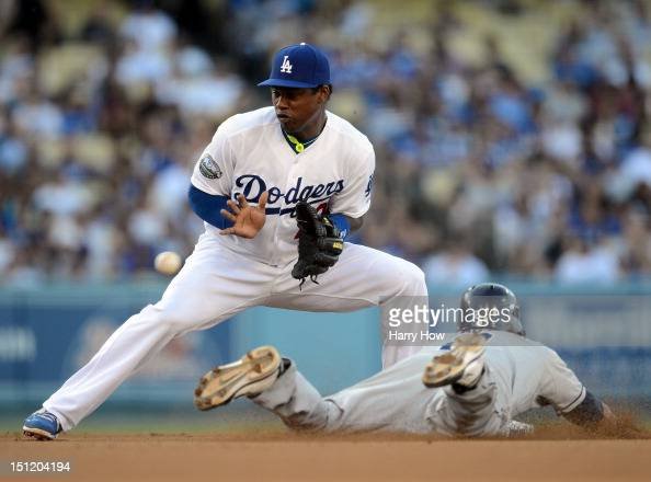 Hanley Ramirez of the Los Angeles Dodgers takes a throw to second base as Everth Cabrera of the San Diego Padres steals the base during the third...