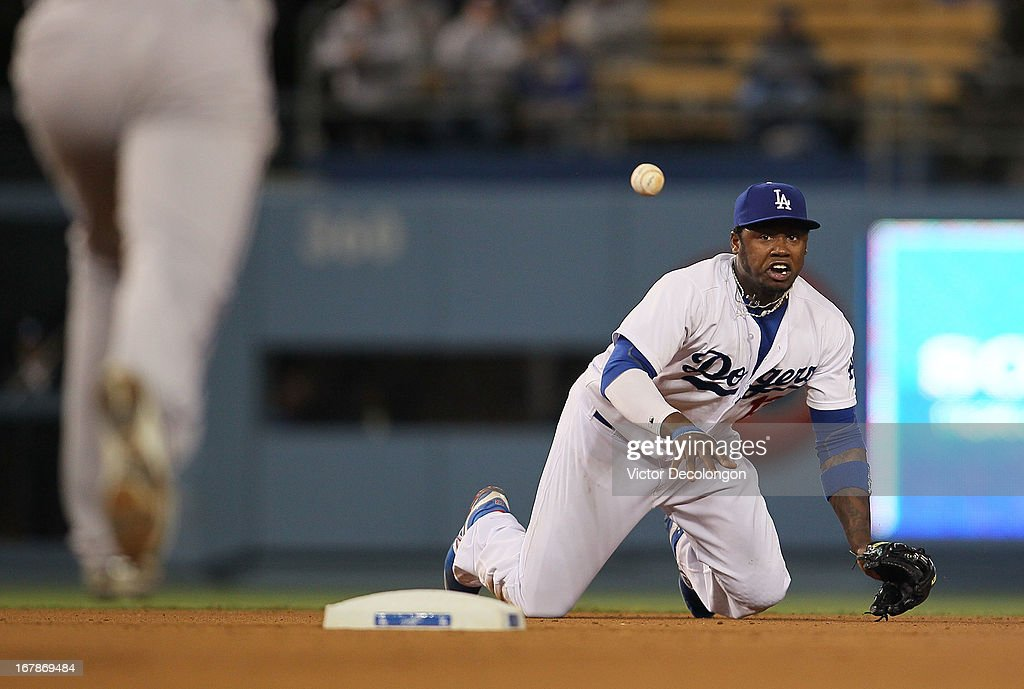 <a gi-track='captionPersonalityLinkClicked' href=/galleries/search?phrase=Hanley+Ramirez&family=editorial&specificpeople=538406 ng-click='$event.stopPropagation()'>Hanley Ramirez</a> #13 of the Los Angeles Dodgers tosses the ball to teammate Nick Punto #7 (not in photo) to start the double play in the eighth inning during the MLB game against the Colorado Rockies at Dodger Stadium on April 30, 2013 in Los Angeles, California. Punto got Josh Rutledge #14 of the Colorado Rockies on the force out at second and threw out Carlos Gonzalez #5 of the Colorado Rockies at first base to complete the double play. The Dodgers defeated the Rockies 6-2.
