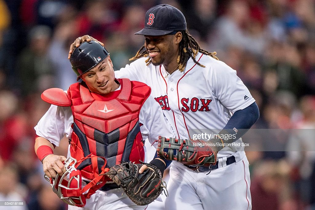 Hanley Ramirez #13 reacts with Christian Vazquez #7 of the Boston Red Sox during the second inning of a game against the Colorado Rockies on May 24, 2016 at Fenway Park in Boston, Massachusetts.