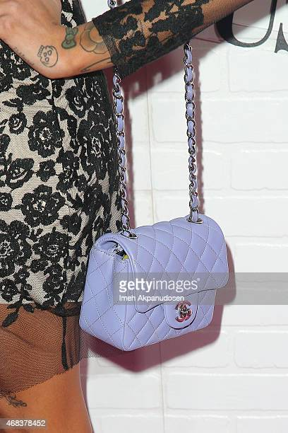 Hanna Beth purse detail attends the JustFab Apparel Launch Event at Sunset Tower on April 1 2015 in West Hollywood California