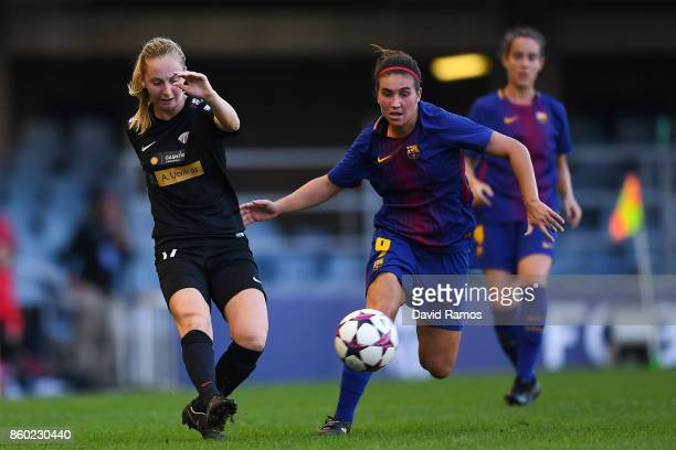 Hanna Dahl of Avaldsnes competes for the ball with Mariona Caldentey of FC Barcelona during the UEFA Womens Champions League round of 32 match...