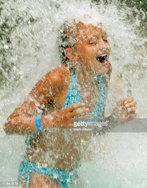 Hanna Fowler cools off under one of the waterfalls at the Chesapeake Beach Water Park July 31 2006 in Chesapeake Beach Maryland Temperatures in the...