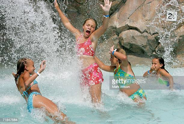 Hanna Fowler Jordan Hartford Haley Hartford and Olivia Fowler play in the water fall at the Chesapeake Beach Water Park July 31 2006 in Chesapeake...