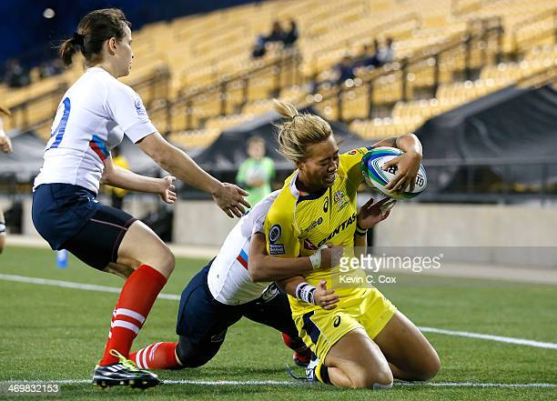 Hanna Sio of Australia scores a try against Nadezda Kudinova and Marina Petrova of Russia during the Women's Sevens World Series at Fifth Third Bank...