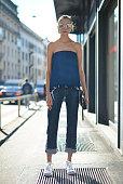 Hanna Zosimova poses wearing a Moony top Acne jeans Adidas shoes Margiela bag and Fendi sunglasses before the Max Mara show during the Milan Fashion...