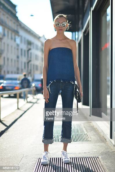 Hanna Zosimova poses wearing a Moony top Acne jeans Adidas shoes Margiela bag and Fendi sunglasses before the Max Mara show during the Milan Fashion...