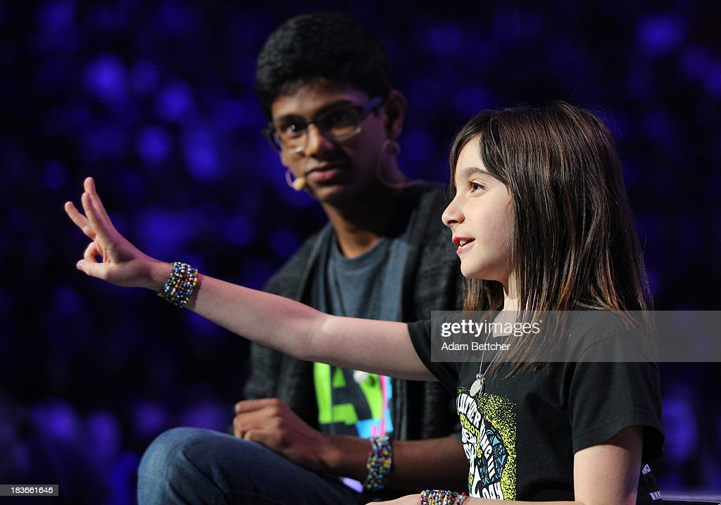 Hannah Alpert and Siddarth Paari inspire fellow students during the We Day Minnesota event at the Xcel Energy Center in St. Paul, Minnesota on October 8, 2013