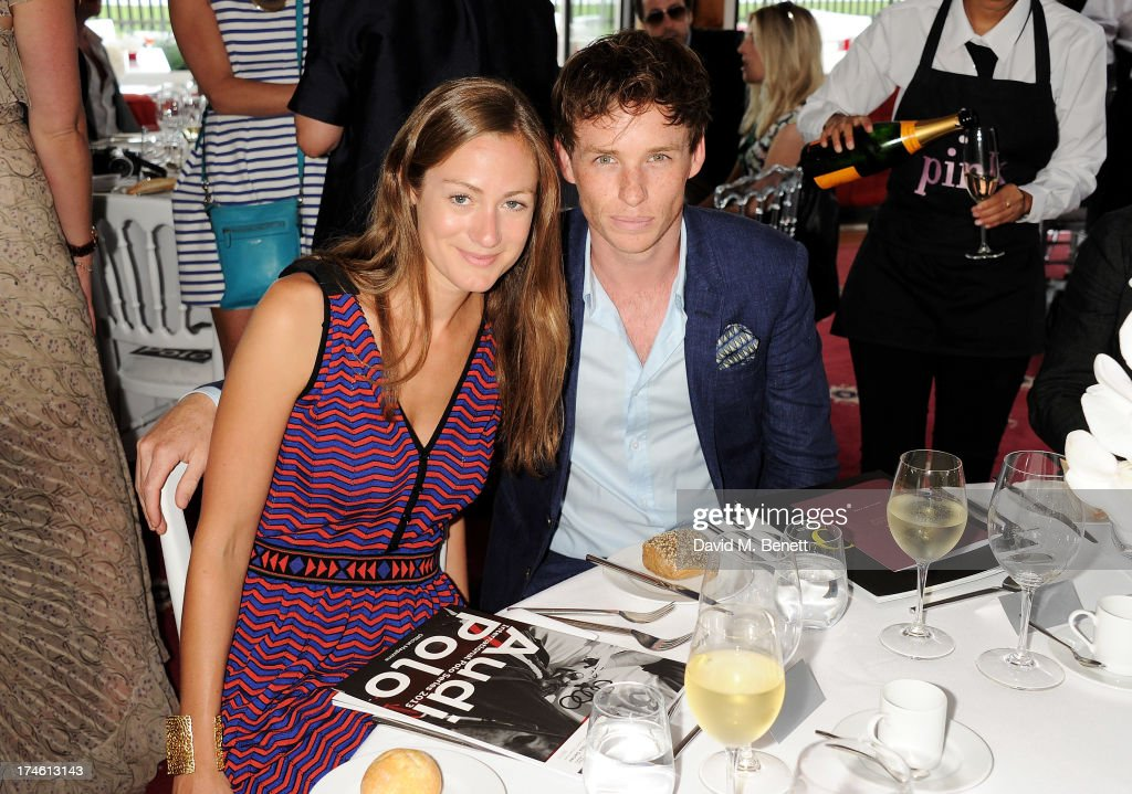 Hannah Bagshawe (L) and Eddie Redmayne attend the Audi International Polo at Guards Polo Club on July 28, 2013 in Egham, England.
