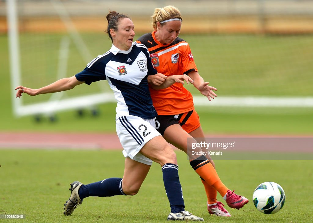 Hannah Beard of the Roar is challenged by the defence of Maika Ruyter-Hooley of the Victory during the round six W-League match between the Brisbane Roar and the Melbourne Victory at the Queensland Sport and Athletics Centre on November 24, 2012 in Brisbane, Australia.