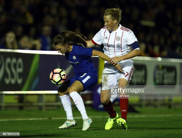 Hannah Blundell of Chelsea Ladies is tackled by Melanie Behringer of Bayern Munich during the UEFA Womens Champions League Round of 32 First Leg...