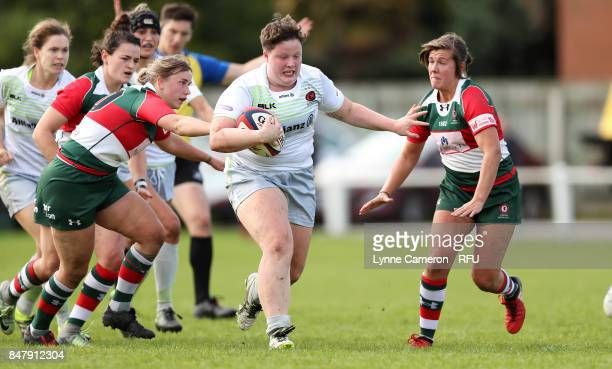 Hannah Botterman of Saracens Women holds off Sarah Beckett and Beth Stott of Firewood Waterloo Ladies during the Tyrrells Premier 15 at The Memorial...