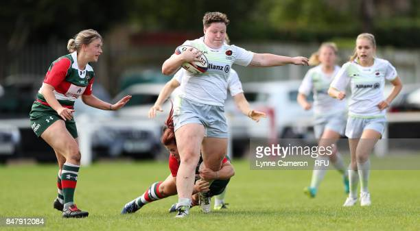 Hannah Botterman of Saracens Women holds off Sarah Beckett of Firewood Waterloo Ladies during the Tyrrells Premier 15 at The Memorial Ground on...