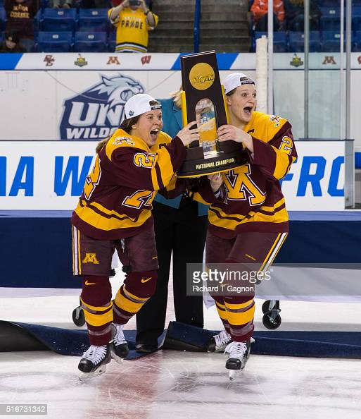 Hannah Brandt of the Minnesota Golden Gophers and teammate Lee Stecklein raise the championship trophy after winning the 2016 NCAA Division I Women's...