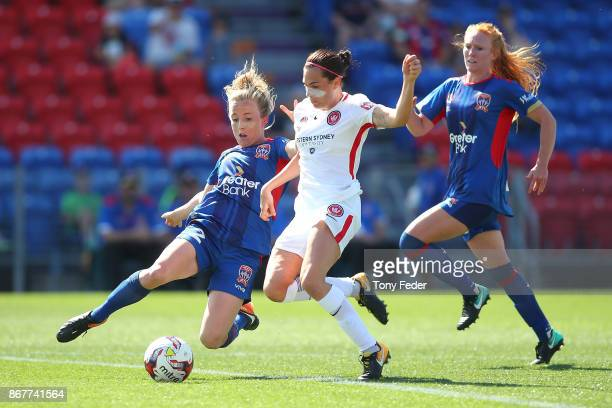 Hannah Brewer of the Jets contests the ball with Rosie Dee Sutton of the Wanderers during the round one WLeague match between the Newcastle Jets and...
