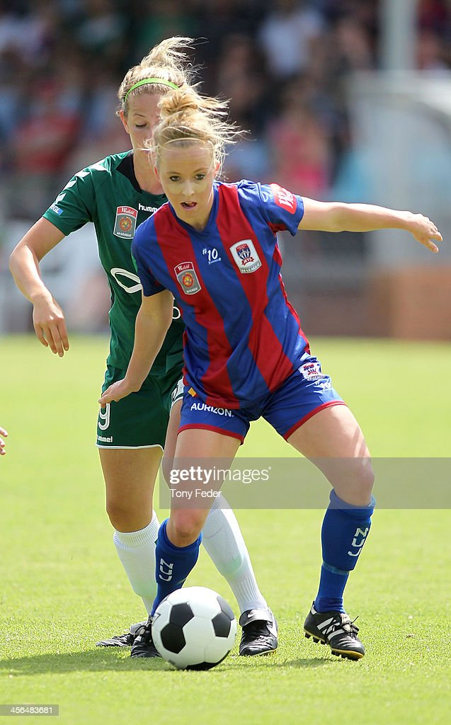 Hannah Brewer of the Jets controls the ball ahead of Grace Gill of Canberra United during the round five W-League match between the Newcastle Jets and Canberra United at Wanderers Oval on December 14, 2013 in Newcastle, Australia.