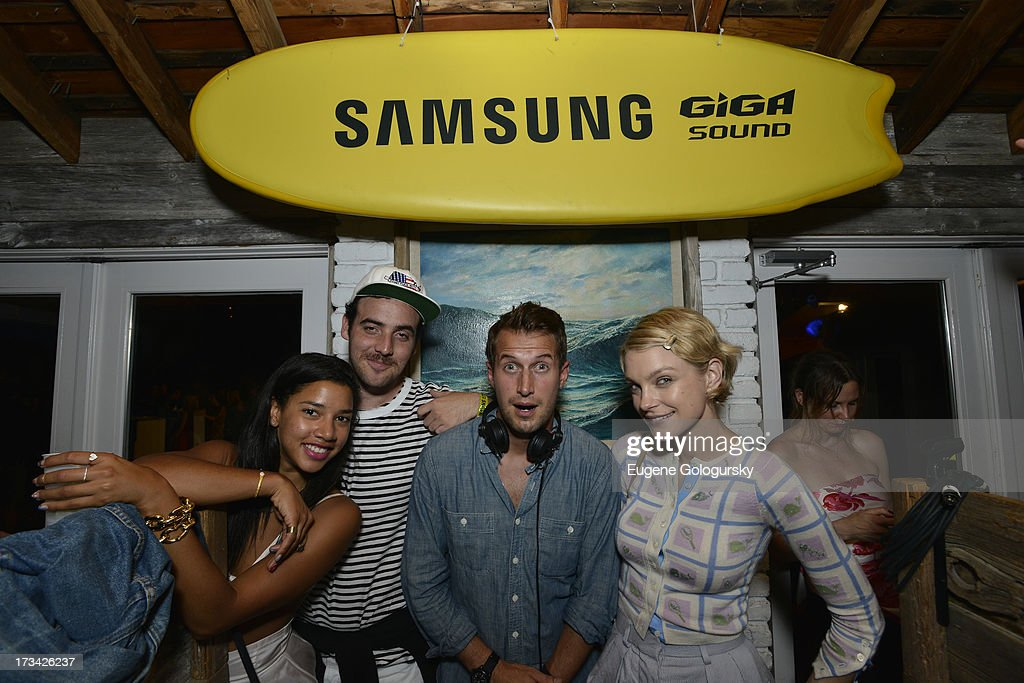 Hannah Bronfman and beau, Brendan Fallis, in the DJ booth showing model, <a gi-track='captionPersonalityLinkClicked' href=/galleries/search?phrase=Jessica+Stam&family=editorial&specificpeople=657570 ng-click='$event.stopPropagation()'>Jessica Stam</a>, the ropes on Samsung's brand new Giga Sound system at Surf Lodge on July 13, 2013 in Montauk, New York.