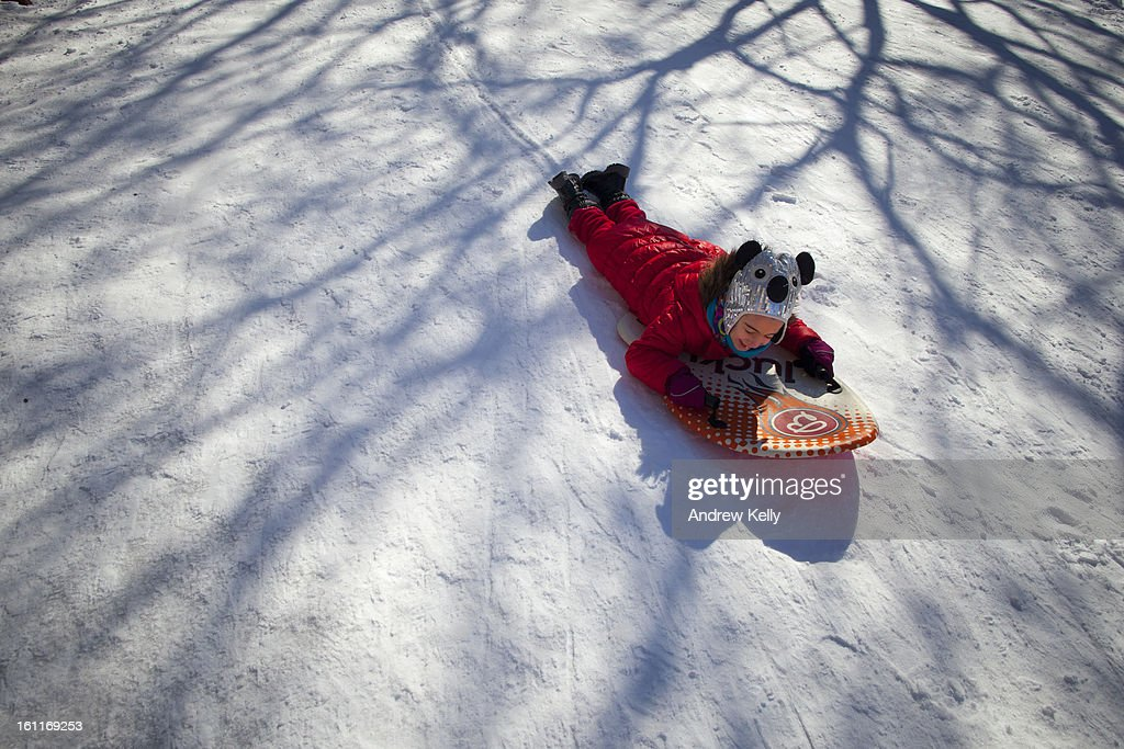 Hannah Ciniglio, 6, plays on her sled following a major winter storm on February 9, 2013 in New York City. New York City and much of the Northeast received a foot or more of snow overnight. Heavy snow warnings are in effect from New Jersey through southern Maine.