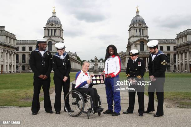 Hannah Cockcroft and Asha Phillip pose for pictures with Naval Officers and the medals for the World Para Athletics Championships and IAAF World...