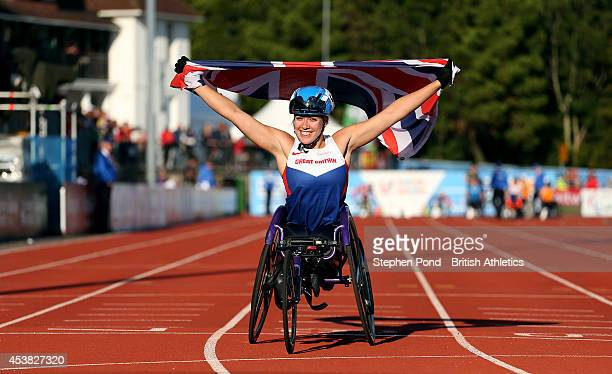 Hannah Cockcroft of Great Britain celebrates winning the Women's 100m T34 event during day one of the IPC Athletics European Championships at Swansea...