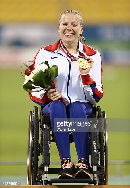 Hannah Cockroft of Great Britain poses with the gold at the medal ceremony for the Women's 100m T34 Final during the Evening Session on Day One of...