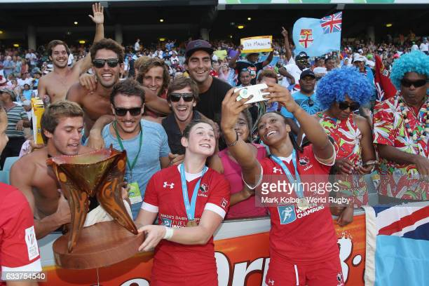 Hannah Darling and Charity Williams of Canada celebrate with the crowd as they pose with the trophy after victory during the womens cup final match...