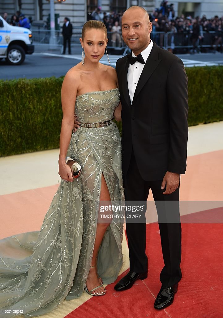 Hannah Davis and Derek Jeter arrive for the Costume Institute Benefit at The Metropolitan Museum of Art May 2, 2016 in New York. / AFP / TIMOTHY
