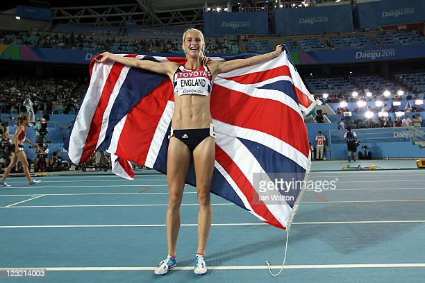 Hannah England of Great Britain celebrates with her country's flag after claiming silver in the women's 1500 metres final during day six of the 13th...