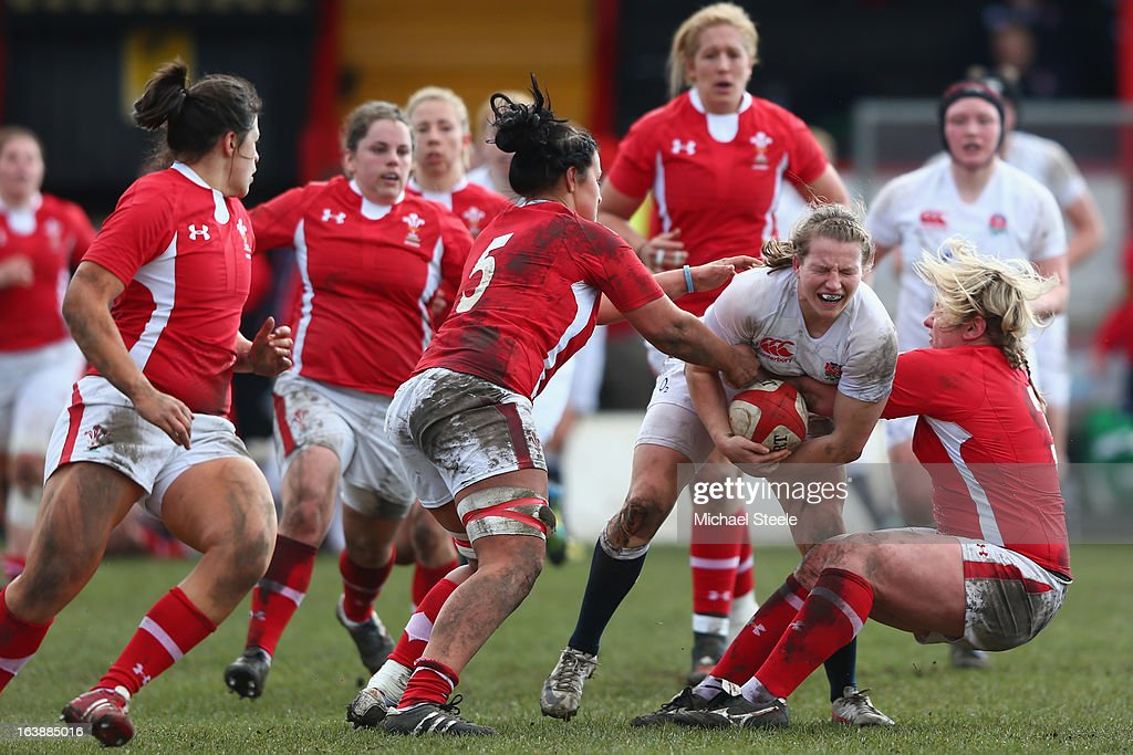 Hannah Gallagher (2R) of England is tackled by Catrin Edwards (R) of Wales during the Wales v England Womens Six Nations match at the Talbot Athletic Ground on March 17, 2013 in Port Talbot, Wales.