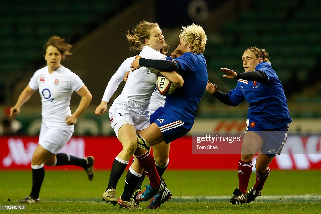 Hannah Gallagher of England runs into Laetitia Grand of France during the Women's RBS Six Nations match between England and France at Twickenham Stadium on February 23, 2013 in London, England.