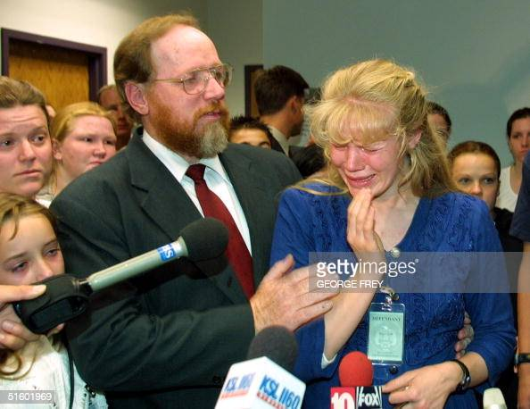 Hannah Green breaks down and cries as she talks to reporters after learning that her husband Utah polygamist Tom Green was convicted of four counts...