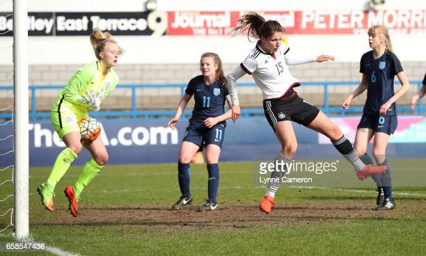 Hannah Hampton of England saves from Melissa Kossler of Germany during the England v Germany U17 Girl's Elite Round match on March 27 2017 in Telford...