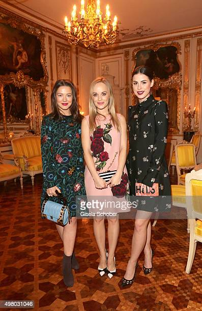 Hannah Herzsprung Friederike Kempter and Lena MeyerLandrut pose during the mytheresacom X Gianvito Rossi dinner at St Emmeram Castle on November 19...