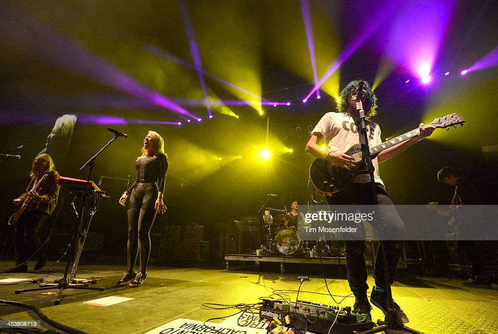 Hannah Hooper (C) and Christian Zucconi of Grouplove perform as part of Radio 94.7's Electric Christmas at Sleep Train Arena on December 4, 2013 in Sacramento, California.