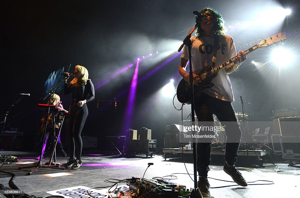 Hannah Hooper (L) and Christian Zucconi of Grouplove perform as part of Radio 94.7's Electric Christmas at Sleep Train Arena on December 4, 2013 in Sacramento, California.