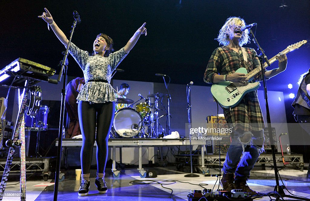 Hannah Hooper (L) and Christian Zucconi of Grouplove perform during KROQ's Almost Acoustic Christmas Day Two at Gibson Amphitheatre on December 9, 2012 in Universal City, California.