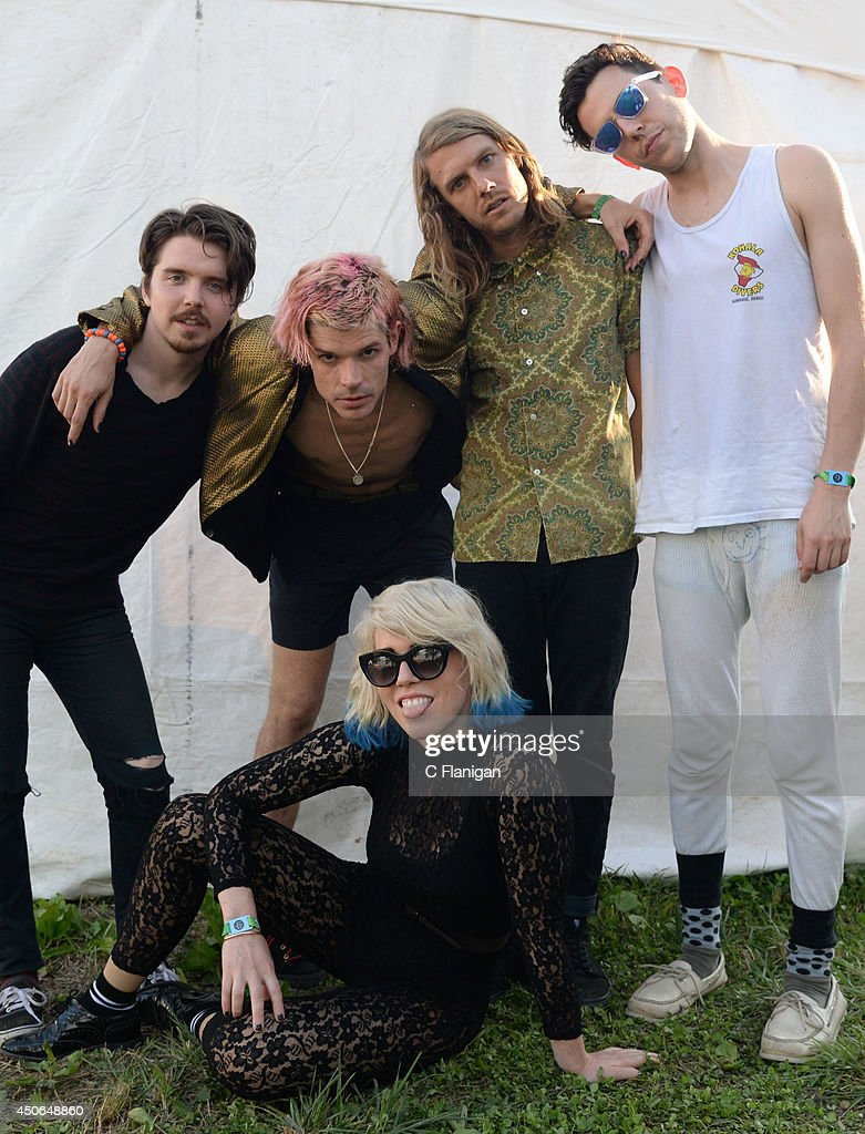 Hannah Hooper, Christian Zucconi, Sean Gadd, Andrew Wessen and Ryan Rabin of Grouplove pose backstage during the 2014 Bonnaroo Music & Arts Festival on June 14, 2014 in Manchester, Tennessee.