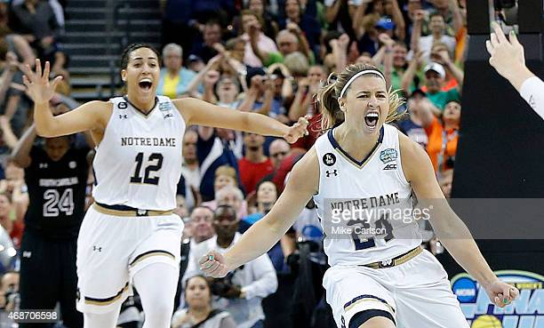 Hannah Huffman and Taya Reimer of the Notre Dame Fighting Irish celebrate their 66 to 65 win over the South Carolina Gamecocks during the NCAA...
