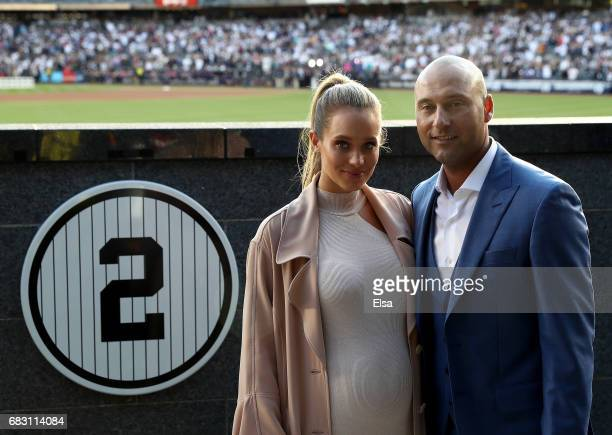 Hannah Jeter and Derek Jeter pose next to his number in Monument Park at Yankee Stadium during the retirement cerremony of Jeter's jersey at Yankee...