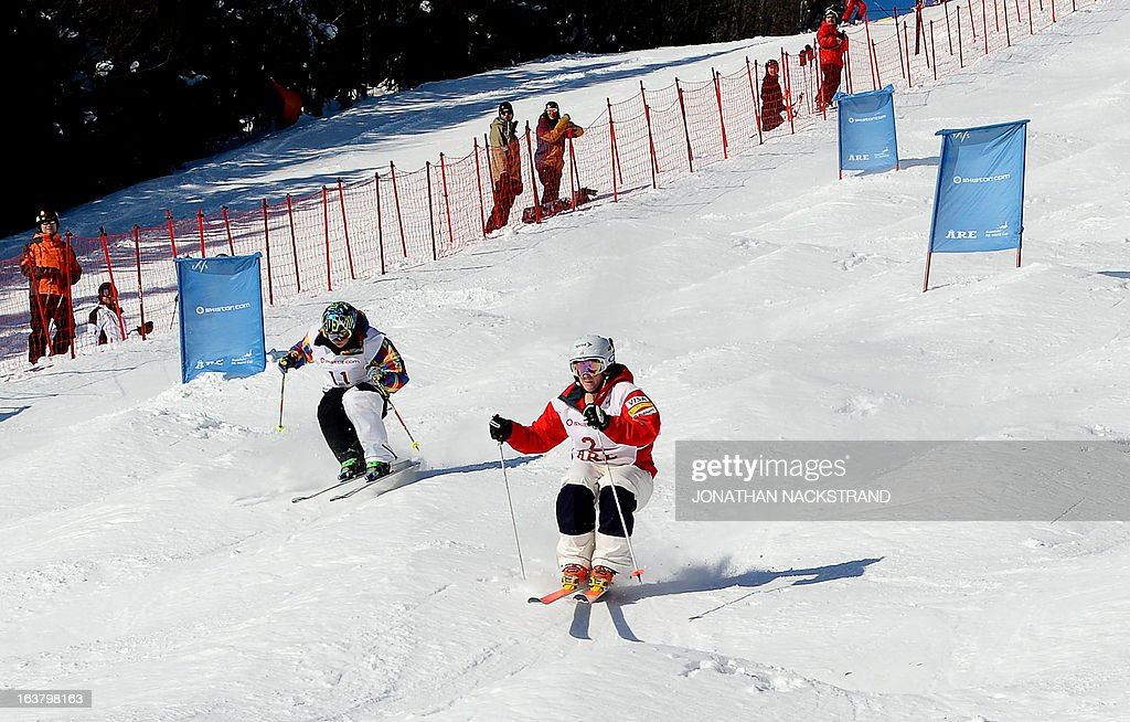 Hannah Kearney (R) of the US competes against Kazakhstan's Yulia Galysheva during the women's Dual Moguls event of the FIS Freestyle World Cup in Are, Sweden, on March 16, 2013.