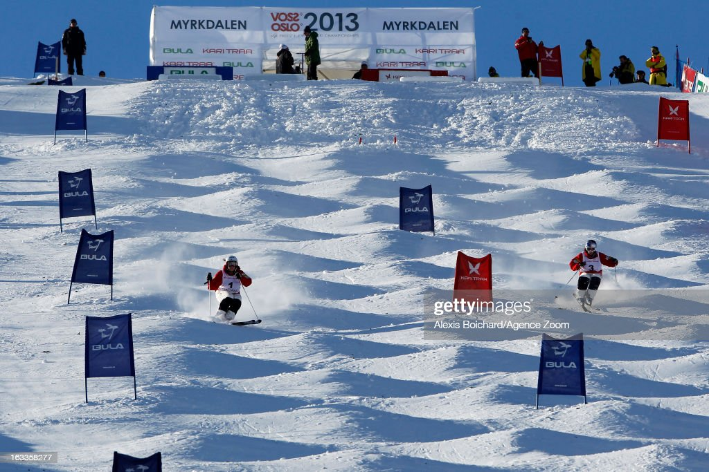 Hannah Kearney (L) of the USA and Heather McPhie of the USA compete during the FIS Freestyle Ski World Championship Men's and Women's Dual Moguls on March 08, 2013 in Voss, Norway.