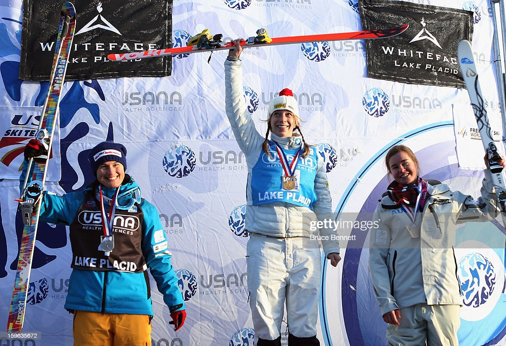 Hannah Kearney of the USA (C) takes first place in the USANA Freestyle World Cup Ladies' Moguls competition at Whiteface Mountain on January 17, 2013 in Lake Placid, New York. Nikola Sodova #4 of the Czech Republic (L) took second place, and Brittany Cox #9 of Austria (R) took third place.