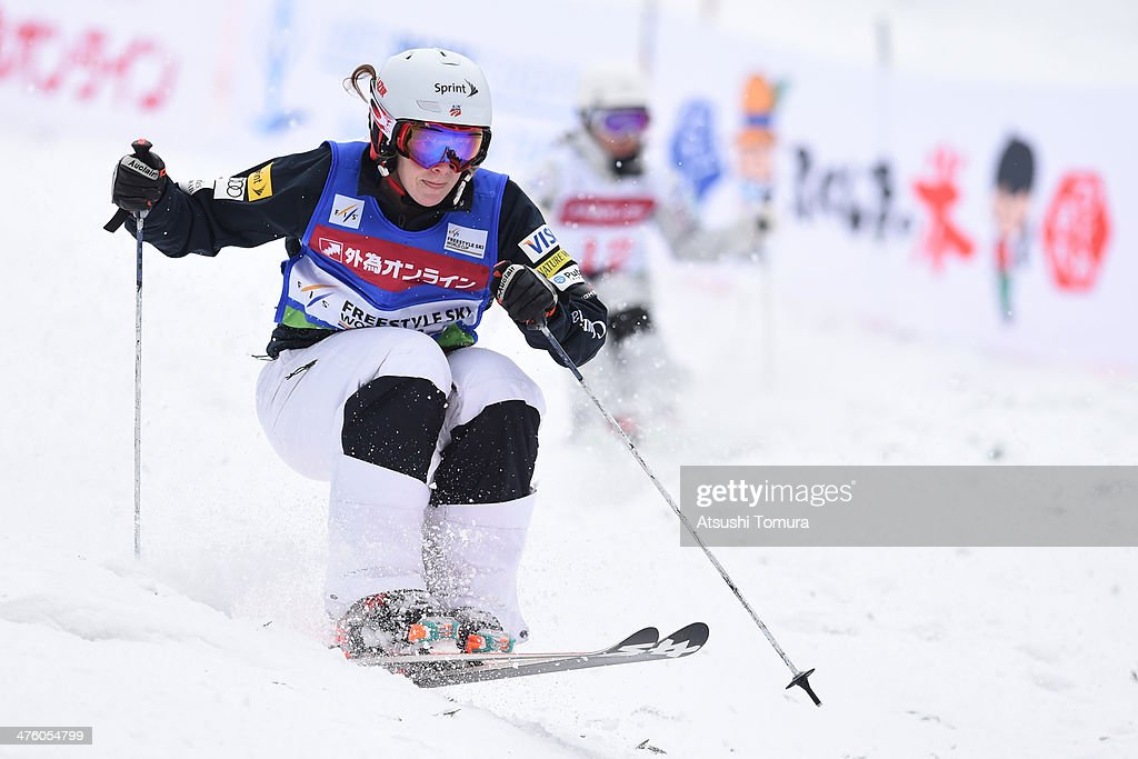 Hannah Kearney of USA and Junko Hoshino of Japan compete in the Ladies' Dual Moguls semi final during 2014 FIS Free Style Ski World Cup Inawashiro at...