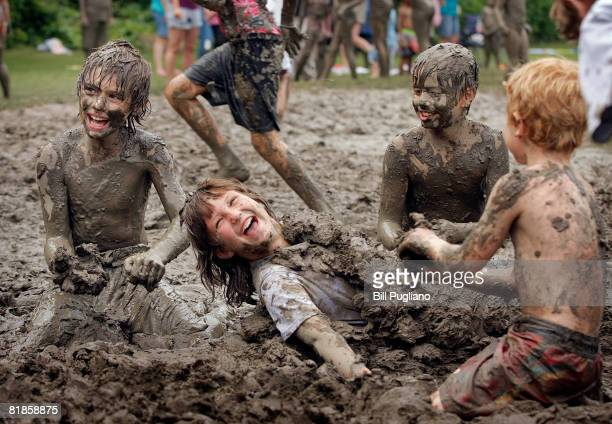 Hannah Knupp age 10 of Livonia Michigan enjoys getting covered with mud by her friends at the annual Mud Day celebration July 8 2008 in Westland...