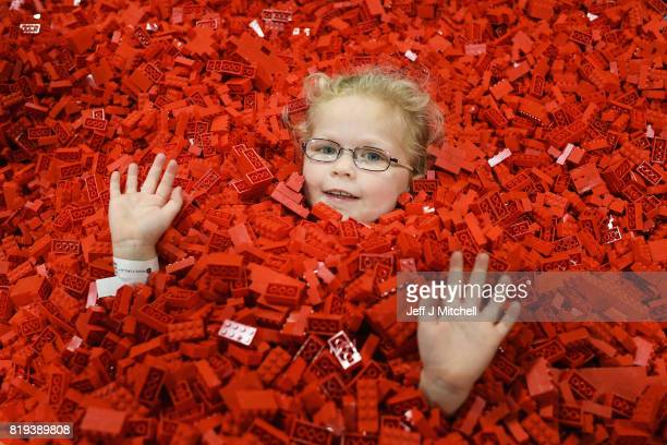 Hannah MacDonald submerses himself in Lego during Bricklive at the Scottish Exhibition and Conference Center on July 20 2017 in Glasgow Scotland...