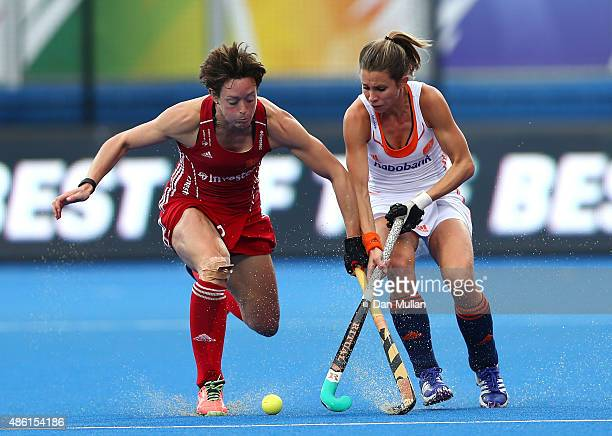 Hannah Macleod of England battles for the ball with Elle Hoog of The Netherlands during the EuroHockey Womens Gold Medal match between England and...