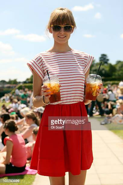 Hannah PadfieldKrala walks with refreshments on Day Two of the Wimbledon Lawn Tennis Championships at the All England Lawn Tennis and Croquet Club on...
